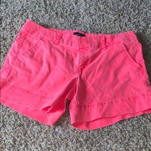 neon pink american eagle pleated midi shorts